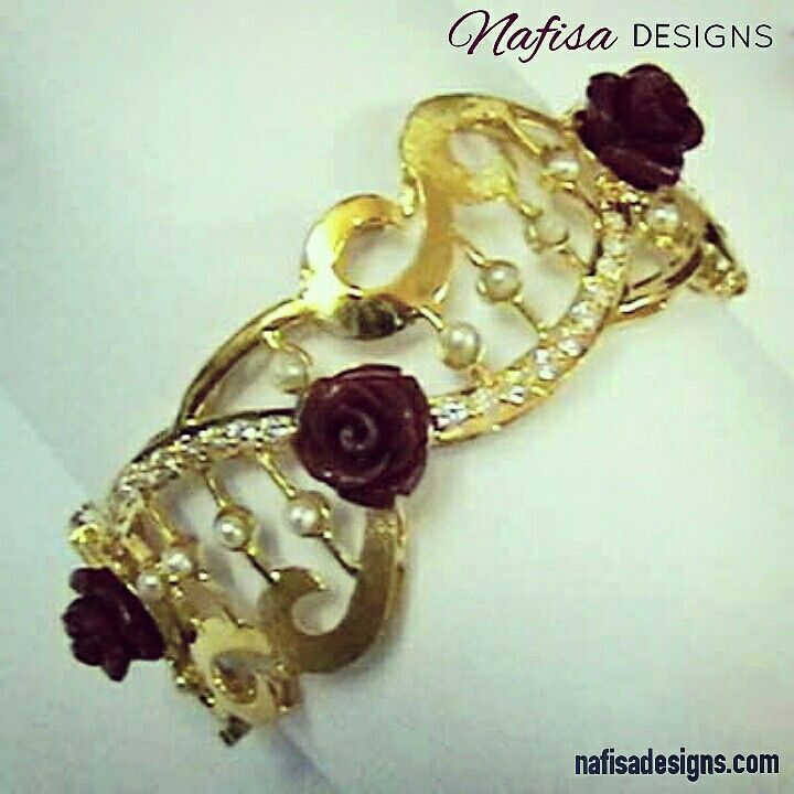 Red Rose in #Gold. #Designer #Bangle for a #wedding dress by #NafisaDesigns  #Kuwait #exclusive #jewelrydesigner #custommade www.nafisadesigns.com  @nafisadesigns  @nafisadesigns  @nafisadesigns  @nafisadesigns