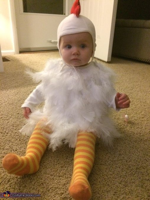 Rachel: I love chickens and thought it would be cute to create a baby chicken costume for my daughters first Halloween! I bought a pilots hat, red felt, a long sleeved...