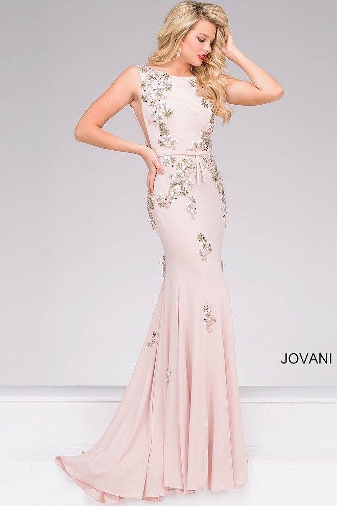 Stunning blush form fitting sleeveless floor length jersey prom dress features beautiful embroidery and beading, sheer panels on the sides, low back and a bow belt, also available in gunmetal.