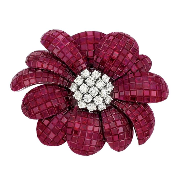 White Gold, Invisibly-Set Ruby and Diamond Flower Pendant-Brooch, Alexis  18 kt., the overlapping petals invisibly-set with square-cut and fancy-shaped rubies approximately 85.61 cts., centering 12 round diamonds approximately 2.60 cts., signed Alexis
