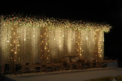 white flowers , mirror hangings , go den and brown sofas , majestic stage decor , pretty stage