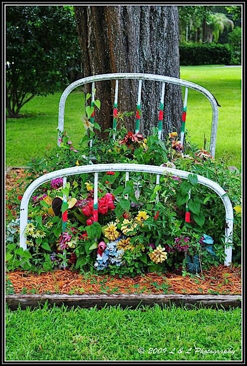 Flower bed.  I am going to try something like this with a bunk bed frame, wish me luck, will post pics when done..