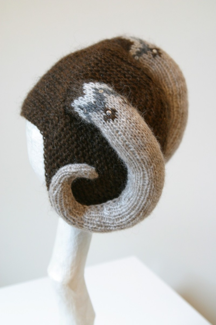 Arndís Bergsdóttir has knitted both horns and the traditional lopapeysa-patterns onto her hats. All made from Icelandic sheep's wool, naturally.- WEIRD BUT  CUTE