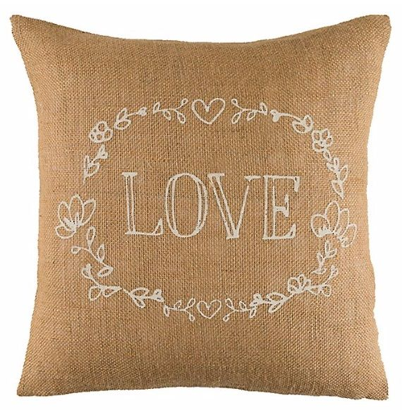 "Add a warm, welcoming touch to your living room, bedroom or any other room with this Timeless Treasures jute throw pillow. A screen printed design in white with the word ""Love"" in the center creates a sweet sentiment that you can showcase anywhere in your home."