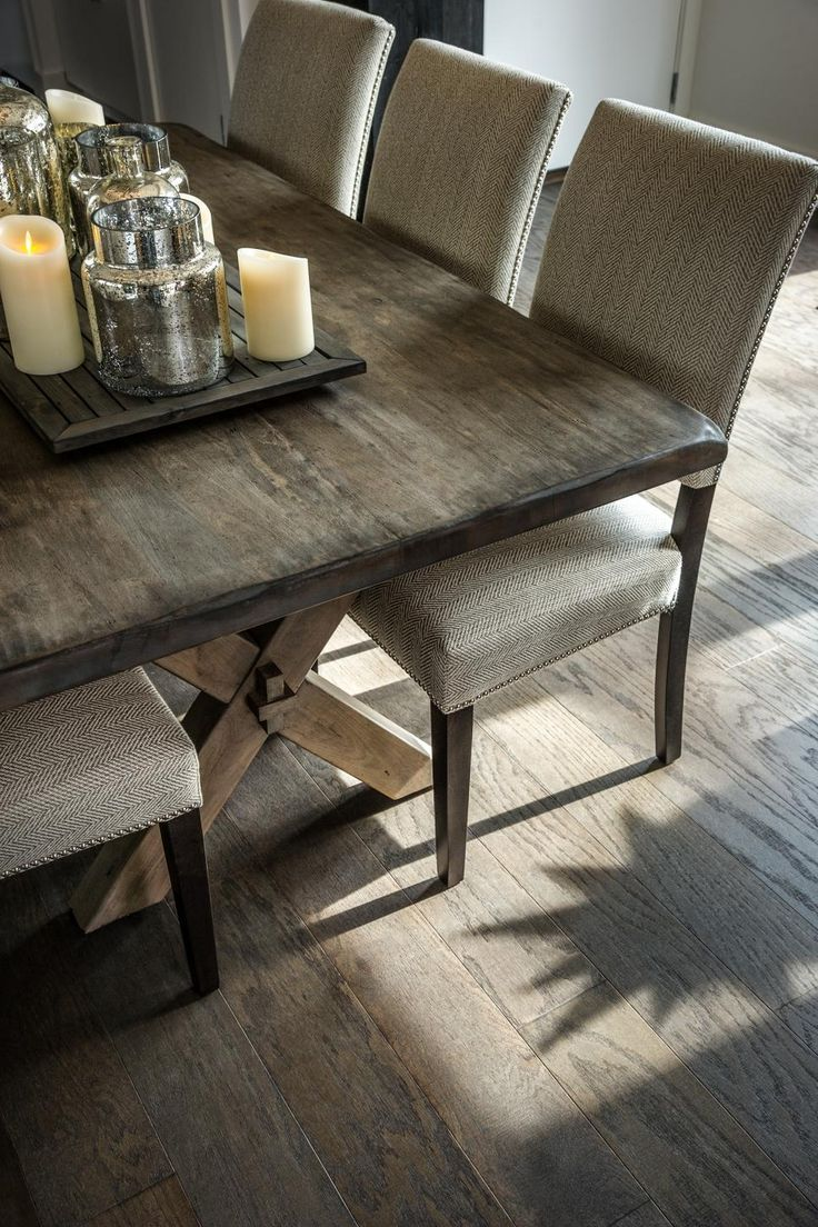 A mix of farmhouse design with modern accessories creates a stylish and welcoming dining area.