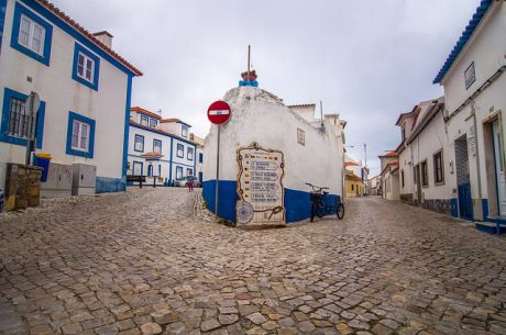 Ericeira, Portugal: Beat the crowds to one of Europe's top surf spots - via Calgary Herald 19.06.2014 | Photo: White-washed bulidings line cobble-stoned streets in Ericeira. Credit: Guillermo Varela.