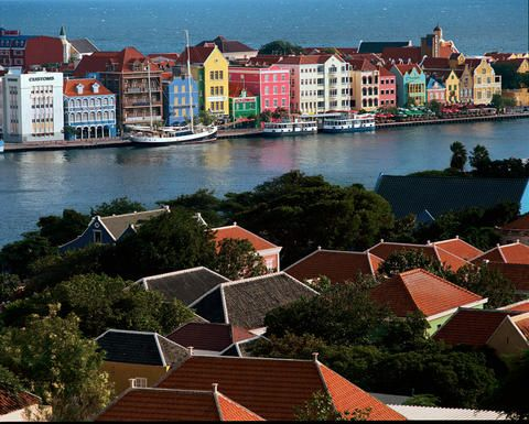 Curacao, The Netherlands Antilles.  Fantastic diving, welcoming people, beautiful architecture, and amazing sunsets.  And it's south of the hurricane belt making it a perfect year-round destination.
