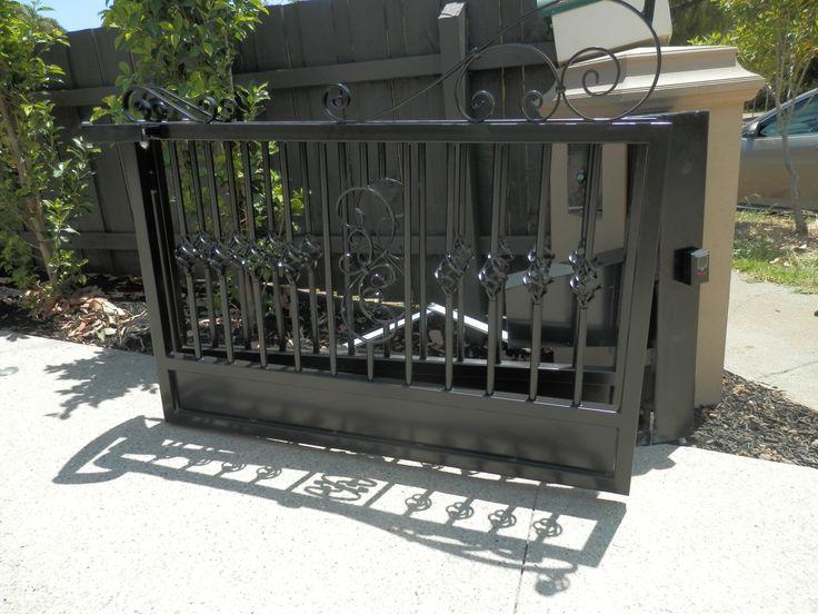Bi-fold Trackless Automatic Gates with Rising Hinges http://www.themotorisedgatecompany.com.au/case-studies