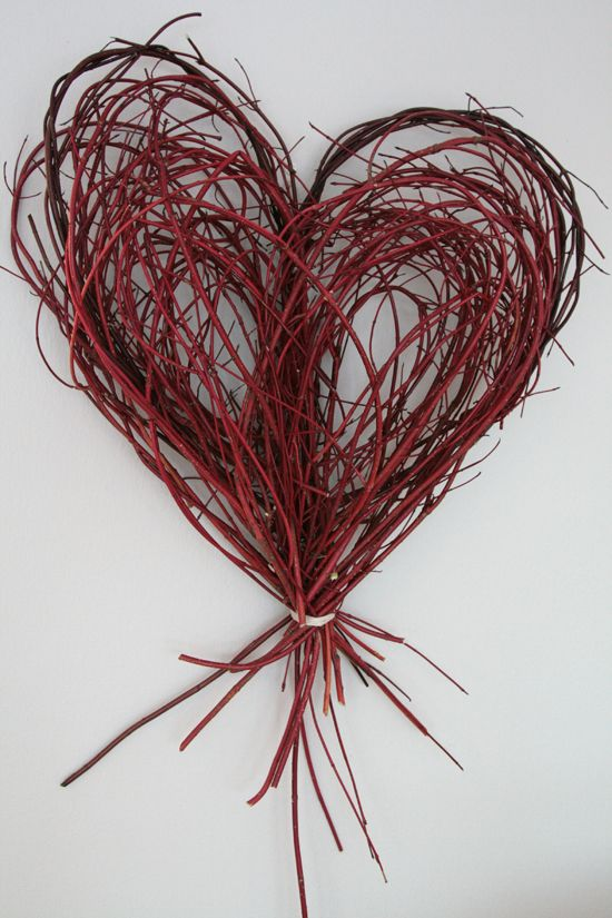 A heart made from branches found outdoors.  P would love to help with this!