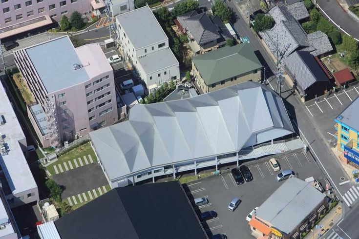 Located at a busy intersection in the motor city of Japan in Suzuka, this church houses a chapel, meeting room and father's residence and is designed by Alphaville Architects for the Catholic Diocese of Kyoto. Photo -© Toshiyuki Yano #japan #aerialphotography #aerialphoto #church #chapel #suzuka #kyoto #roofing #galvanized #steel #sheet