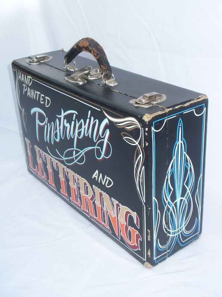 A Pin-stripers mobile bag, with pin stripes and hand lettering.