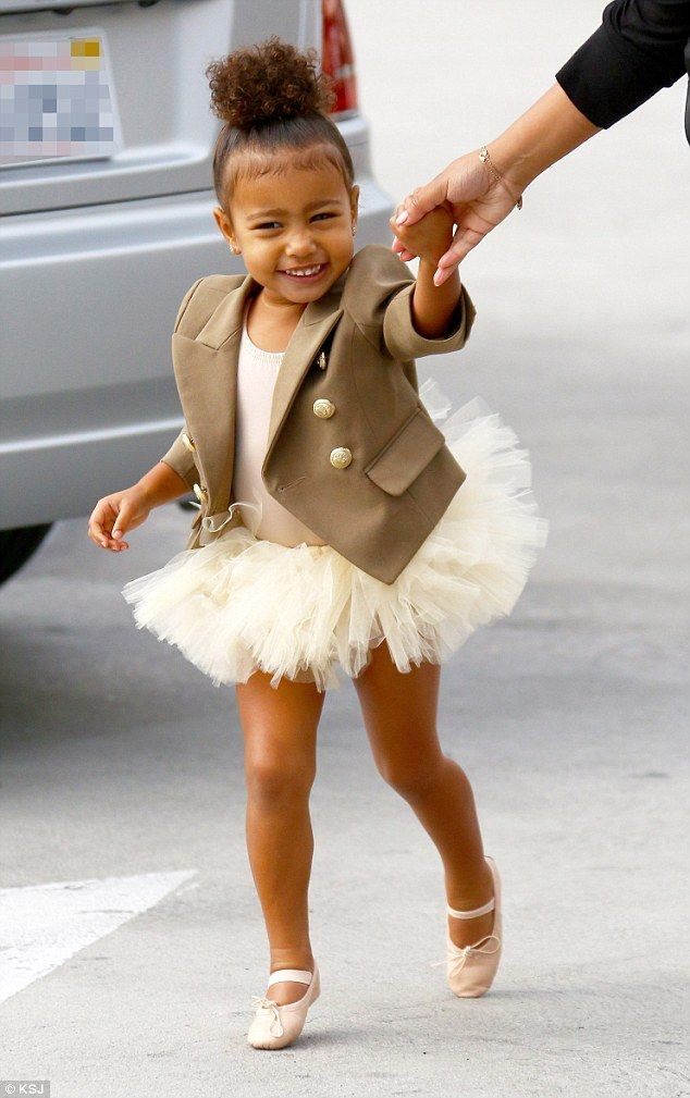 Tip toes: North West was ready for her dance class in a white tutu and designer jacket on Wednesday