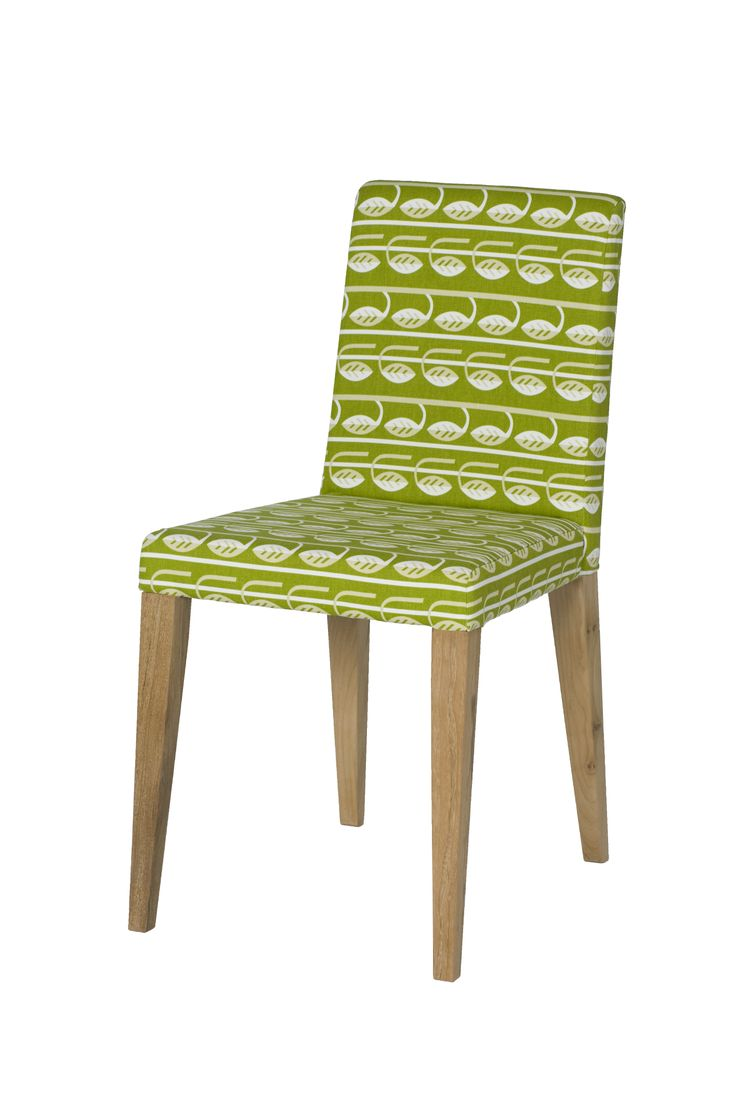Helsinki chair upholstered in 'New Leaf' fabric created by Michelle Mason. The bright bold design of New Leaf was inspired by the design of a classic Moquette fabric (the hardwearing fabric used on London Transport seating). This design is based around the legendary 1930s Colindale Moquette by Marion Dorn, an Art Deco stylised leaf design that was used from 1938 on Tube stock Underground trains.