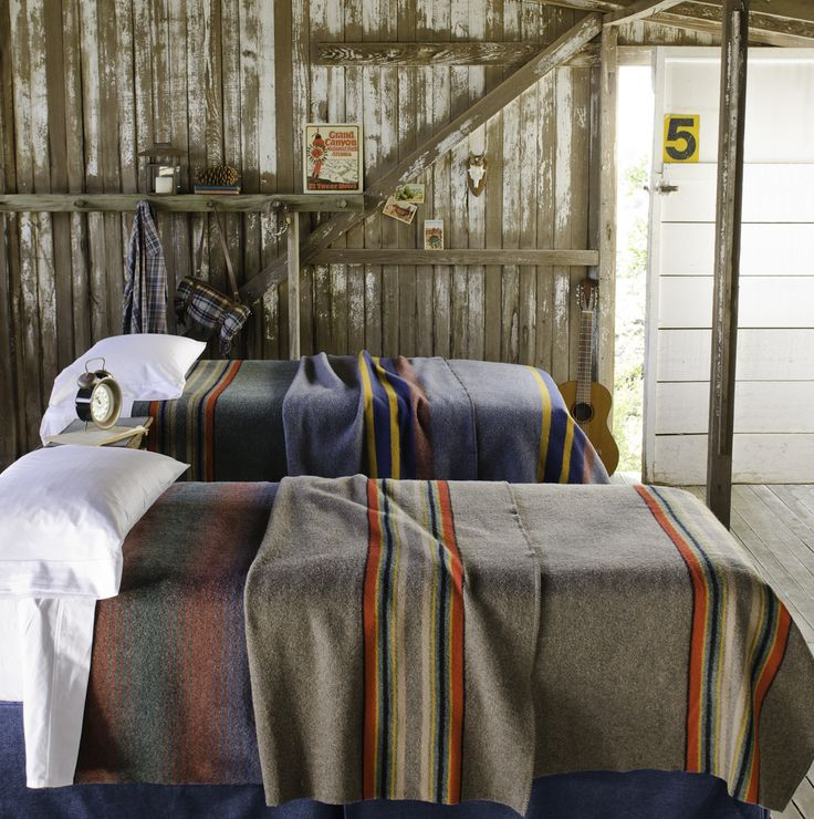 Loft Twin Bed Idea: Striped, wool blankets over crisp, simple, and inexpensive white sheets.  Maybe something coordinating, similar for the queen bed in that room, as well.