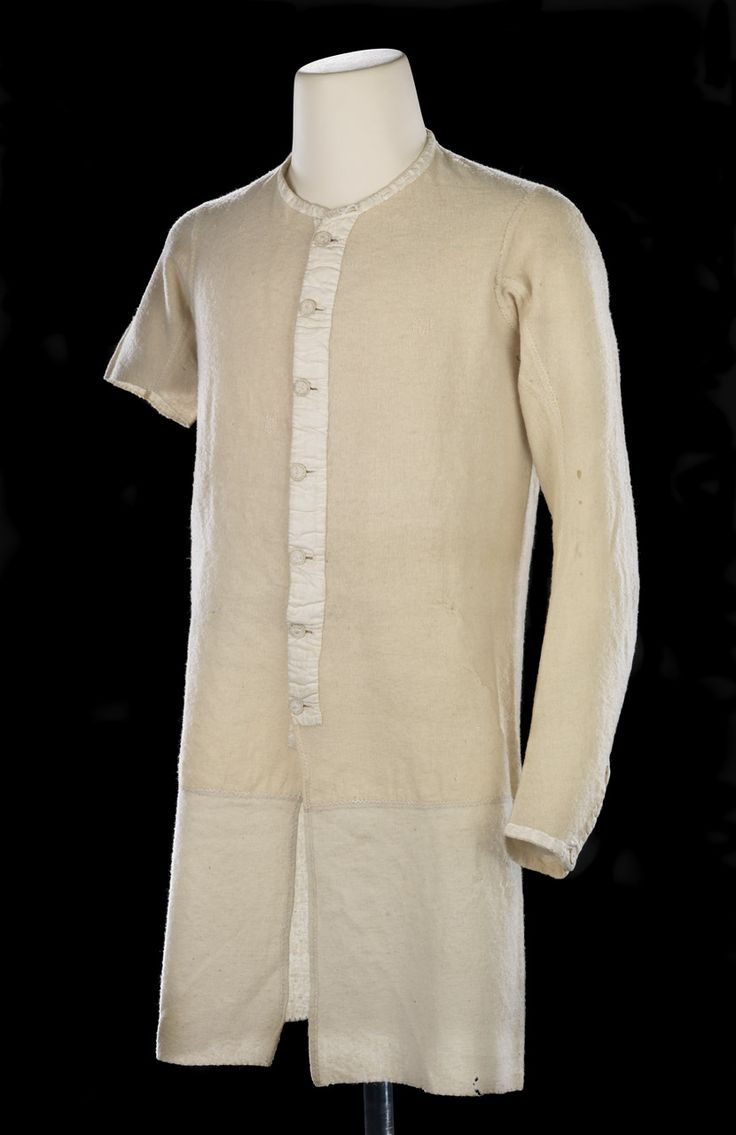 Undershirt belonging to Horatio Nelson. The shirt is made of lightweight cream-coloured wool flannel. The skirt is of a heavier gauge wool flannel. The body is of four panels, the seams are finished with a combination of cross and herring bone stitch in white silk thread. The right sleeve is cut short and the edge is finished with blanket stitch. The collar is edged with linen tape. The shirt fastens in the front with seven dorset buttons which are supported by a strip of linen tape.