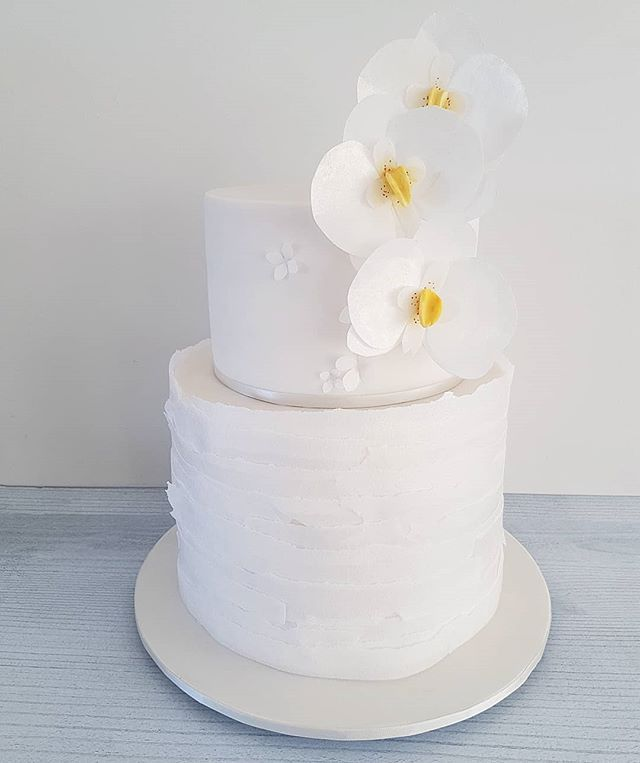 Hi Cakies... Meet' Suzanne'  White on white wafer paper ruffles & wafer paper orchids!  Inspo @heytherecupcake_  www.redapron.com.au
