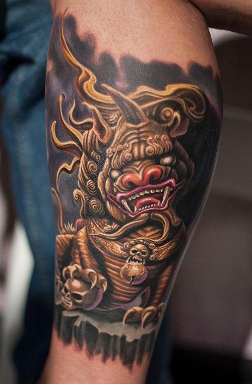 Golden dragon tattoo on leg