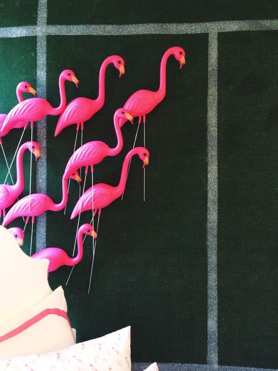 Lawn flamingos clustered on a wall at The Land of Nod