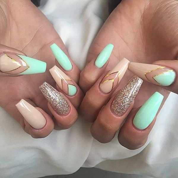 Glittered Coffin Nails with V shaped nail art. Chevron nails is always on the trend and when they are embellished with gold glitter and nude nails, they make great combination.
