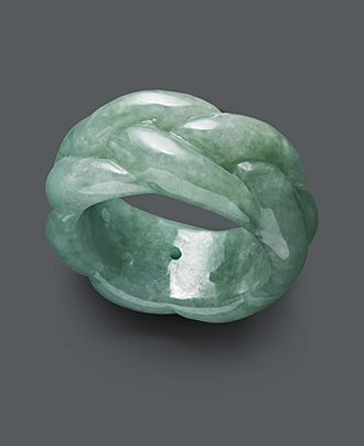 Calm, cool, and collected. Complete your look from head-to-toe with a solid jade ring (12mm) with a unique, braided pattern. Size 7. | Photo may have been enlarged and/or enhanced. | This item cannot
