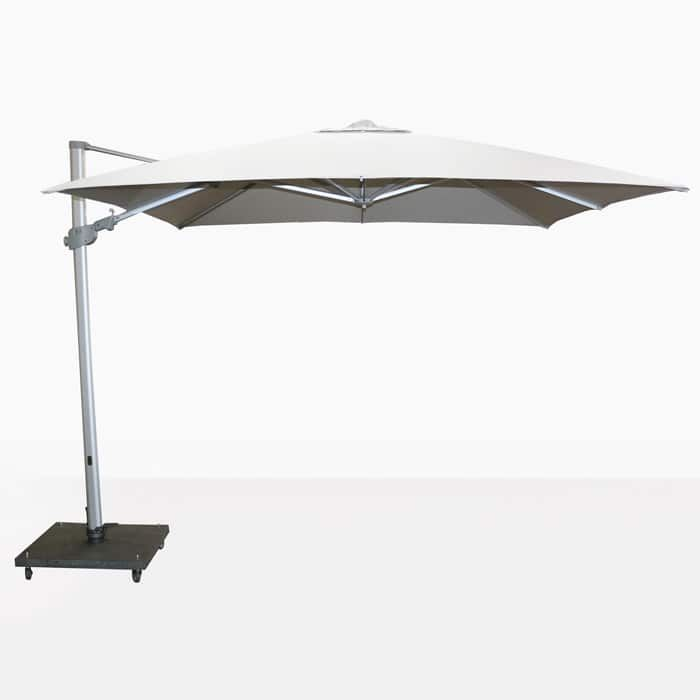The white Mauritius Outdoor Cantilever umbrella is the perfect patio umbrella for big patios. A large canopy offers excellent coverage from sun and weather.