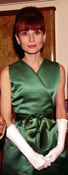 Audrey Hepburn in a green wrap dress and white evening gloves c. 1962-1964