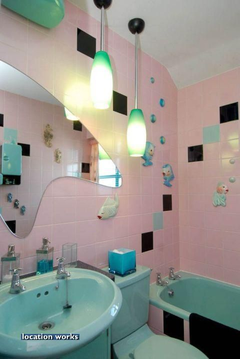 Fishies, boomerang mirror, pink and turquoise! This is pretty close to being my dream bathroom!  :)