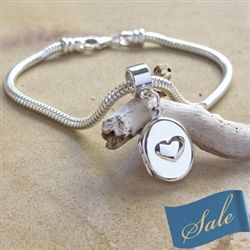 """Pandora"" style bracelet locket.  Fits most bracelets and holds two photos inside."