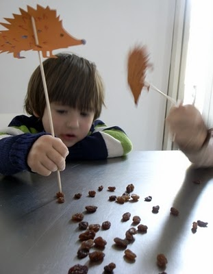 fine motor skills poke raisins with a skewer.  a porcupine is on top.  This would be great for Hedgie or other book units.