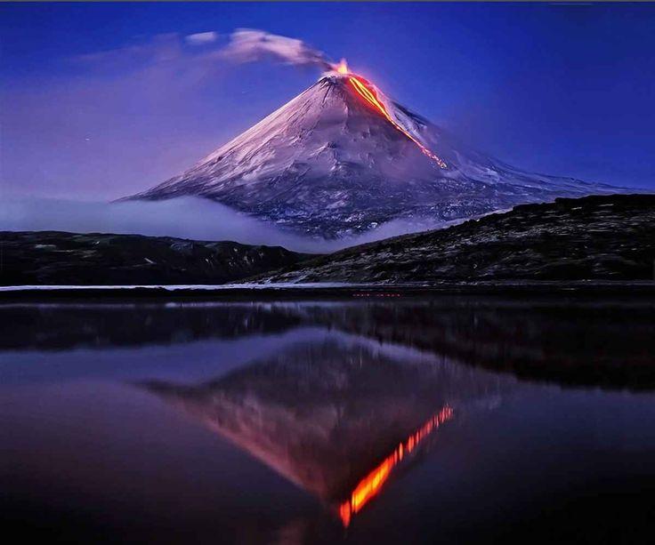 Klyuchevskaya Sopka, located on Kamchatka. Klyuchevskaya Sopka is a stratovolcano which is the highest mountain on the Kamchatka Peninsula of Russia and the highest active volcano of Eurasia