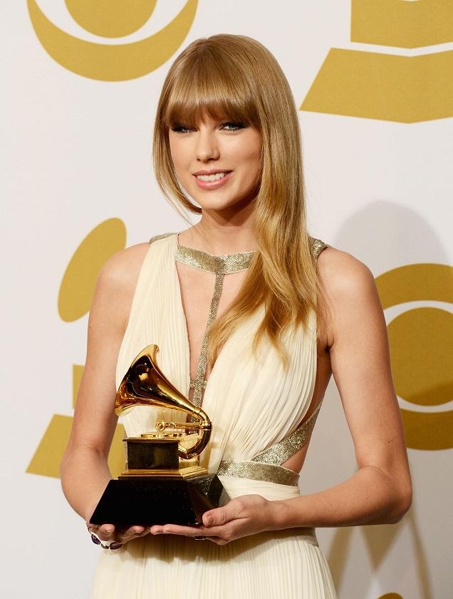 Taylor Swift wears white J. Mendel at the 2013 Grammy Awards in LA
