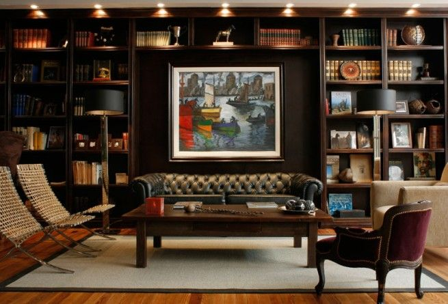 Dark Brown Bookshelves, and Brown Leather Chesterfield Sofa in this Handsome and Masculine Library.