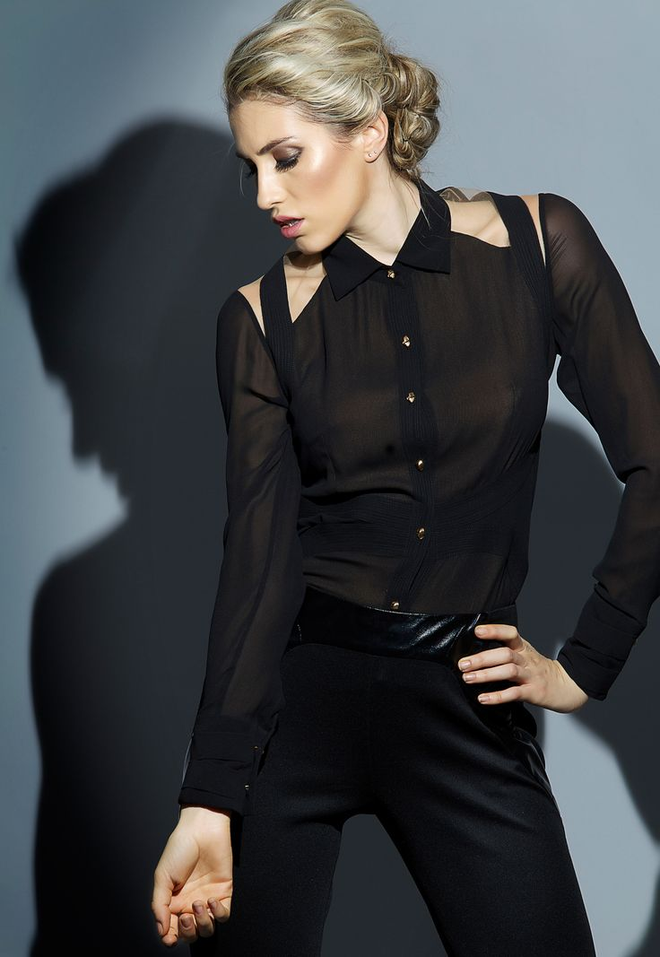 Our black and beige 'Signature' silk shirt has become a modern wardrobe must-have. We love this classic version which will make the perfect partner to pants and skirts alike.