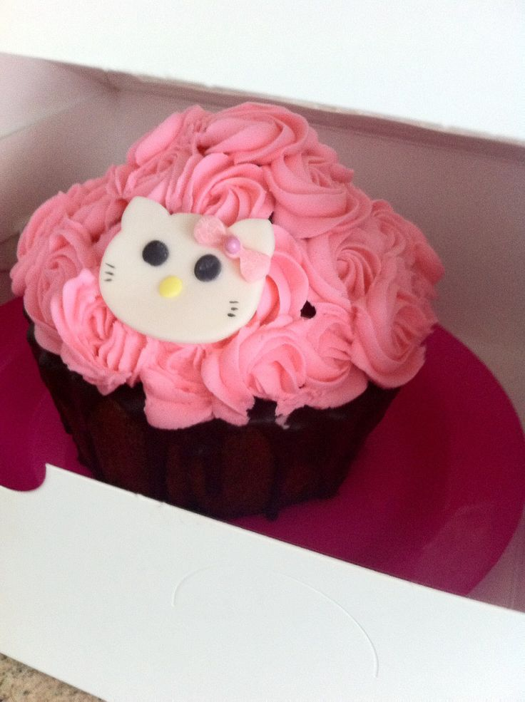 Hello Kitty birthday cake -large cupcake with roses in buttercream