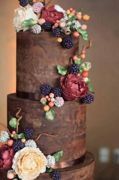 Organic and natural wedding cake with chocolate ganache, ruffles, and handmade sugar blackberries, hypericum berries and peonies, created by Sweet and Swanky Cakes in Bend, OR.