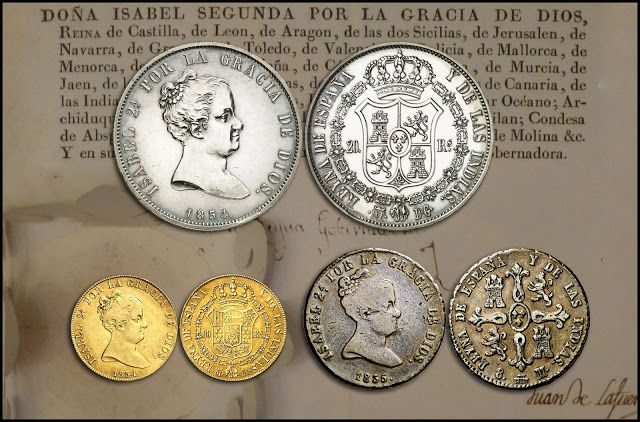 Primeras monedas de oro, plata y cobre, acuñadas con las leyendas en castellano bajo el reinado de Isabel II.
