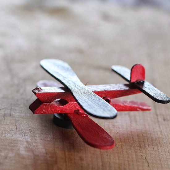 Use clothespins and ice cream sticks to make these Airplane Party Favors; a quick and easy craft or kid's Valentine party activity.