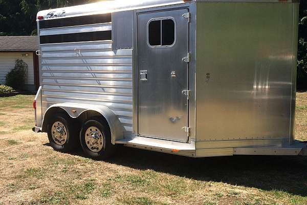 2001 4Star custom built all aluminum 2horse angle haul trailer.Drop down lockable feed windows,removable padded divider,front dressing/tack room with 2 saddle racks,and 10 bridle hooks.Aluminum checker plate floor with rubber mats,2-3500 torsion axles with electric brakes, and height is 7ft. 14,900.