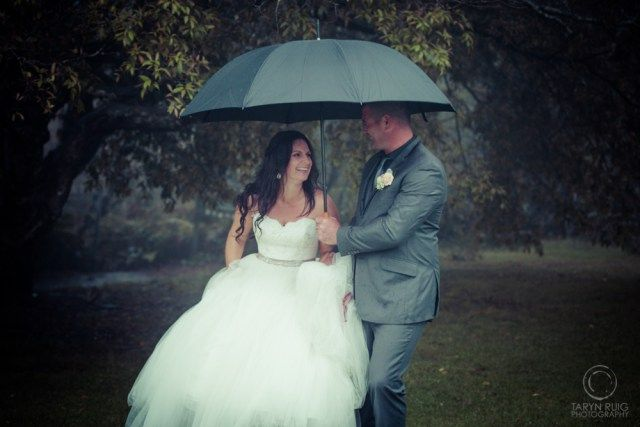 Bride and groom laughing under an umbrella @Sublime Point   Candid Wedding Photography   Taryn Ruig Photography   Weddings, Portraits and Lifestyle Photography   Sydney, Australia   www.tarynruig.com