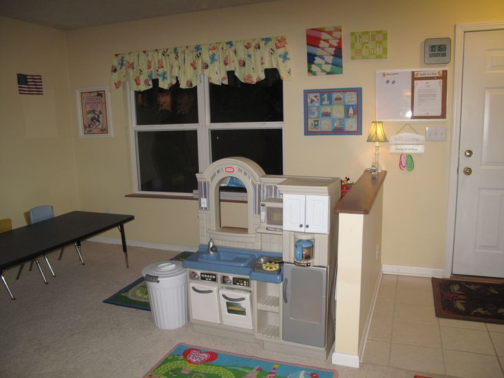 Love the idea of using the back of the kitchen as a wall to separate play areas. Ducks in a Row in home daycare
