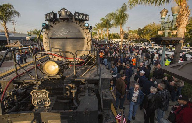 Spectators view the historic locomotive, Union Pacific Big Boy No. 4014 at Metrolink Station, Sunday, Jan. 26, 2014, in Covina, Calif. The 600-ton Big Boy locomotive left the Pomona fairgrounds on its way to a Union Pacific rail yard in Colton, about 60 miles away, where it will be available for two weekends of public viewing before moving on to Cheyenne, Wyo., for restoration work. The goal is to eventually get Engine 4014 back on the rails, said Union Pacific spokesman Aaron Hunt. (AP…