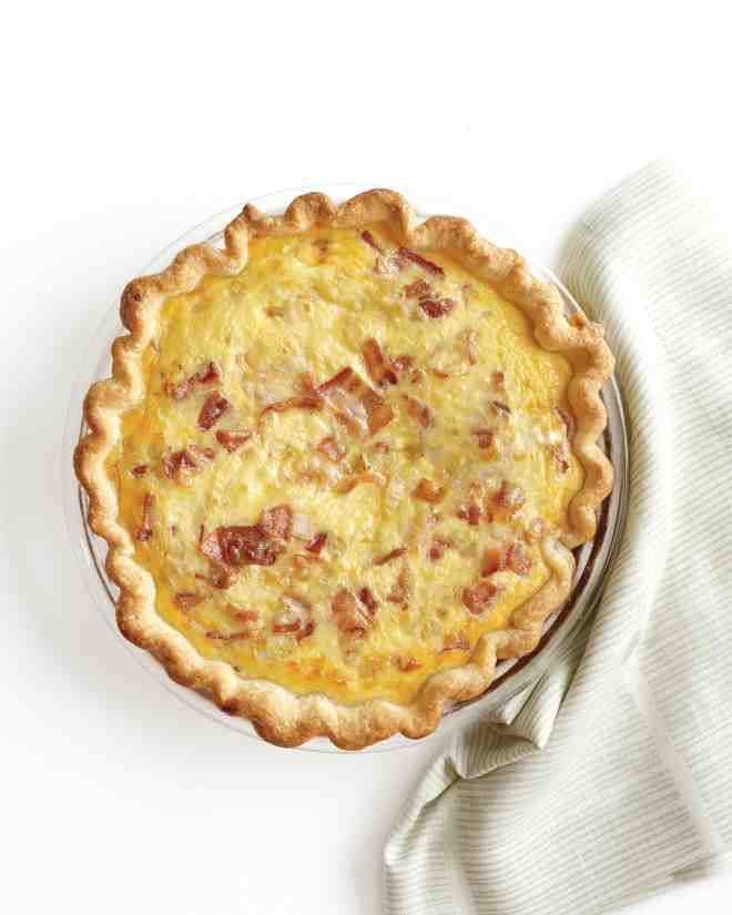 You're probably already familiar with quiche recipes. Rich, savory custard flecked with things like cheese and fresh vegetables baked in a buttery crust, quiche is the perfect make-ahead recipe for company's-coming brunches, lunches, and dinners. Whether you like yours with bacon or spinach, our quiche recipes will keep you and your guests happy.You can't go wrong with this brunch favorite of bacon, Gruyere, and caramelized onions surrounded by rich egg custard and flaky pastry.