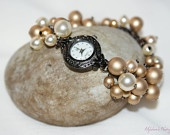 Beautiful cream and gold, Czech glass pearls attached to a bracelet style watch. Genuine Quartz watch used.    £20.00 + p