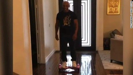 Retired boxer Mike Tyson posted a video of himself wiping out on a hoverboard.