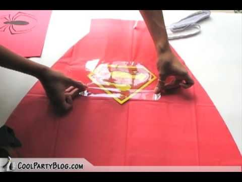 superhero cape from vinyl table cloth!! No sewing! This would make a fantastic party favor for a little boy's super hero party since it looks like you get mulitple capes from each table cloth.