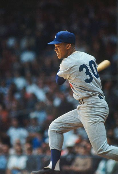 Shortstop Maury Wills #30 of the Los Angeles Dodgers swings hard during the 1960s.
