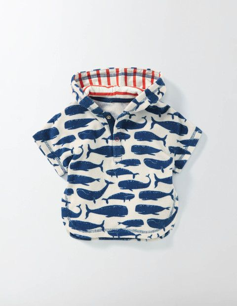 An outing to the beach or the pool just got cosier with our supersoft towelling throw-on. The handy poppers make it easy to pull on or off. We've even added a hood (look out for the fun lining) to keep ears toasty on chillier days.