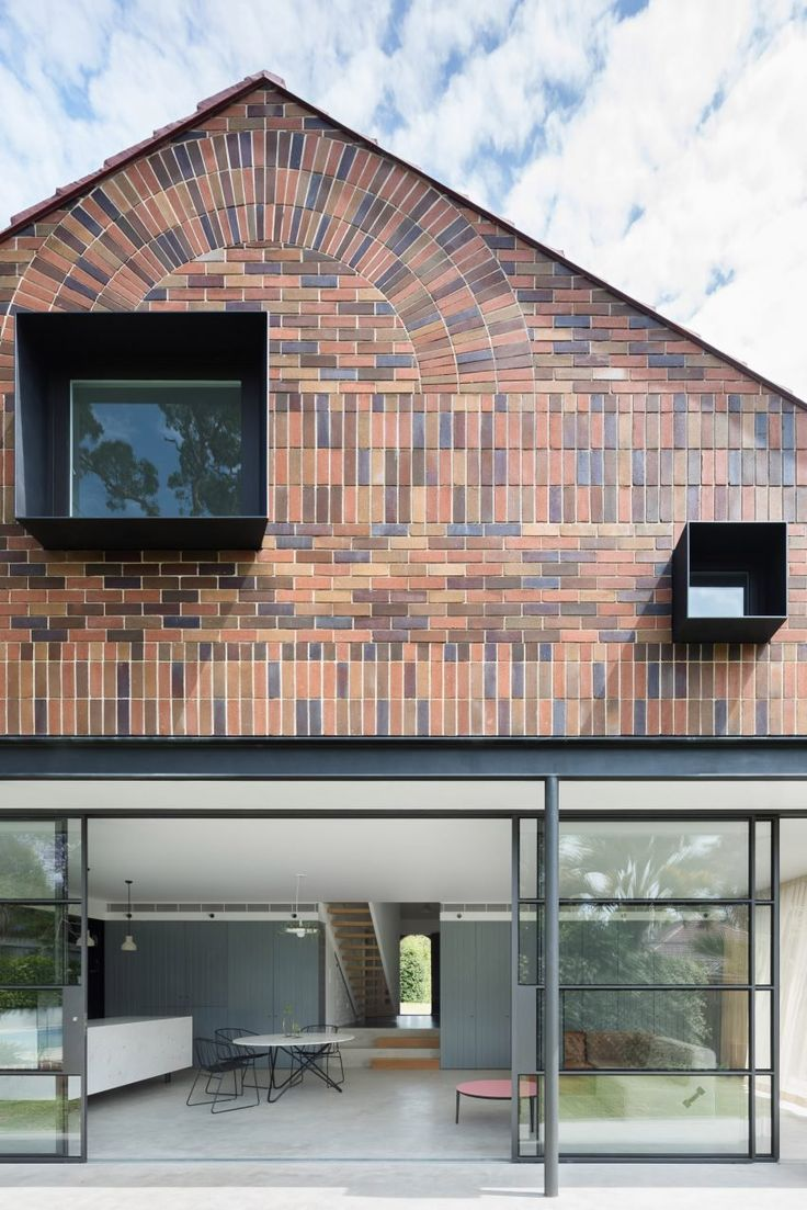 "The bricks are arranged both horizontally and vertically to create gridded patterns, which also integrate a ""brick sunburst"" that copies the detailing above the front door of the original house."