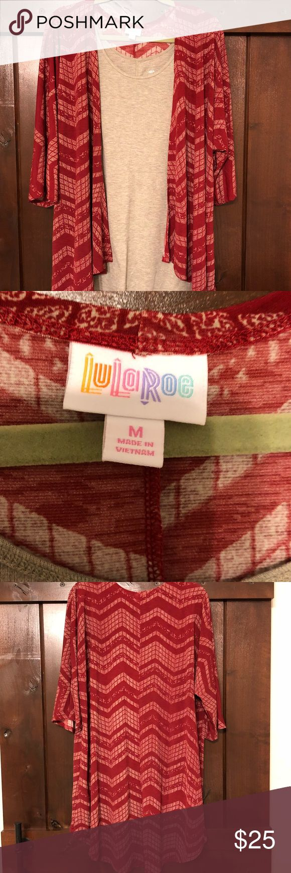 Lularoe Lindsay Kimono style jacket - Med This is a deep red and tan print kimono style jacket from the direct sales company Lularoe. Jacket only worn once. Made from a very lightweight stretch material. Would fit a ladies size 12-20. Camisole shown is not included- for styling purposes only. Jacket is short in the front and longer in the back. The back comes down to the back of my knees so there is ample coverage. Looks great with skinny pants, leggings, slacks and is great to have if you…