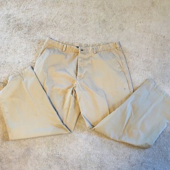 Men's khaki pants Men's khaki pants. Has a small ink spot below the left front pocket George Pants